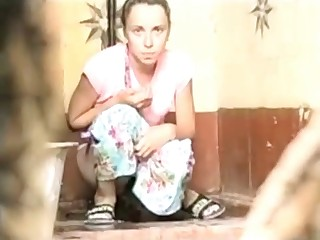 Cute babe shits in public toilet