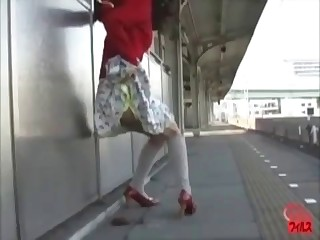 Asian girl is shitting outdoors