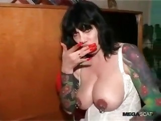 Busty brunette is tasting crap
