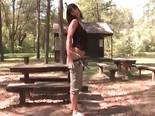 Lass shitting in the woods