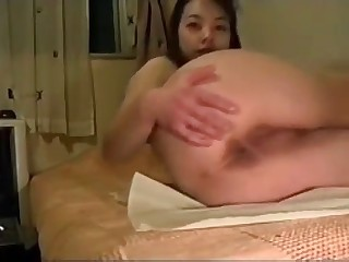 Asian plays with her turd